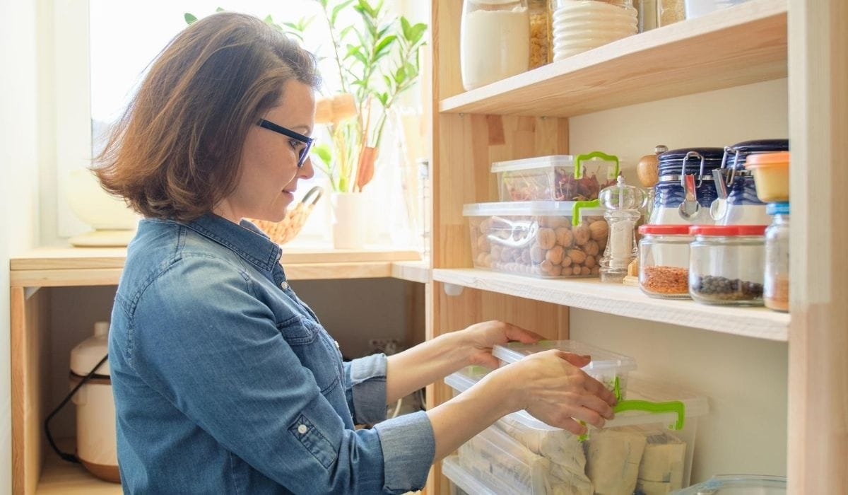 Checking inventory in pantry
