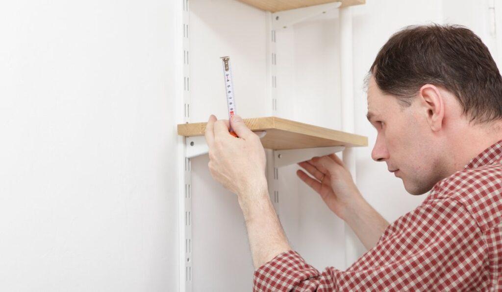 Man installing new shelves