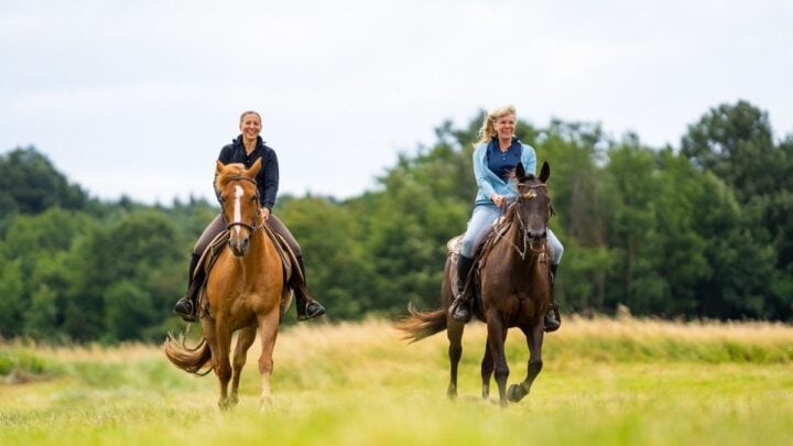 women riding western