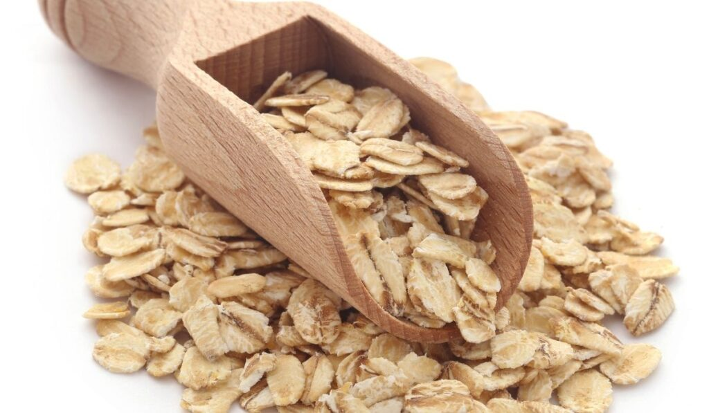 whole oats in a wooden scoop