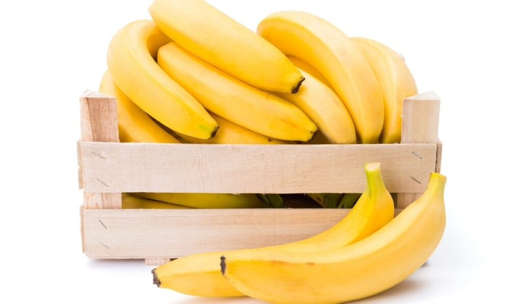 wooden box full of bananas