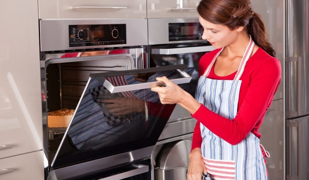 Woman Checking Oven