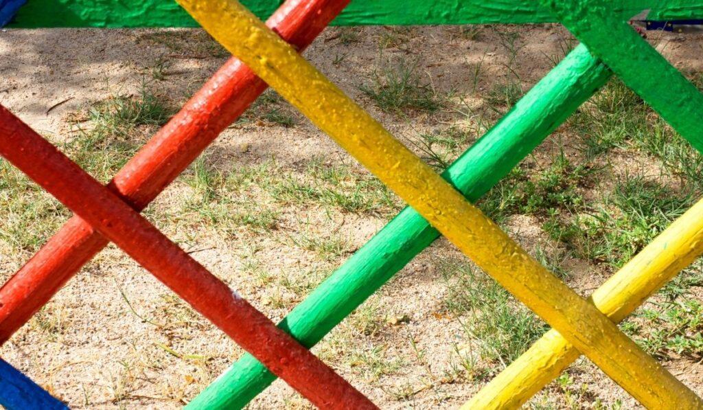 brightly painted fence around children's playground