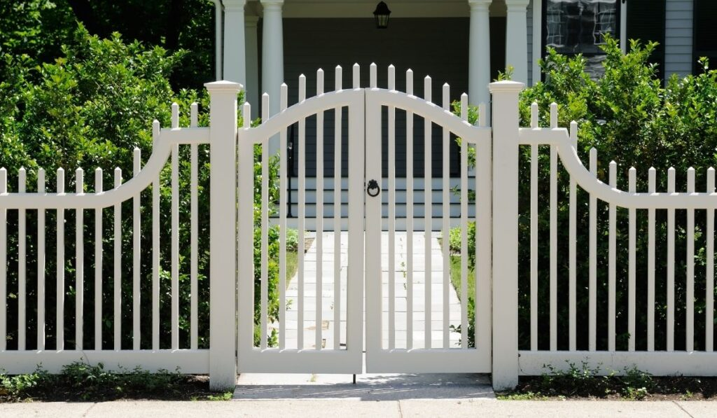 white front gate and fence on a house entrance