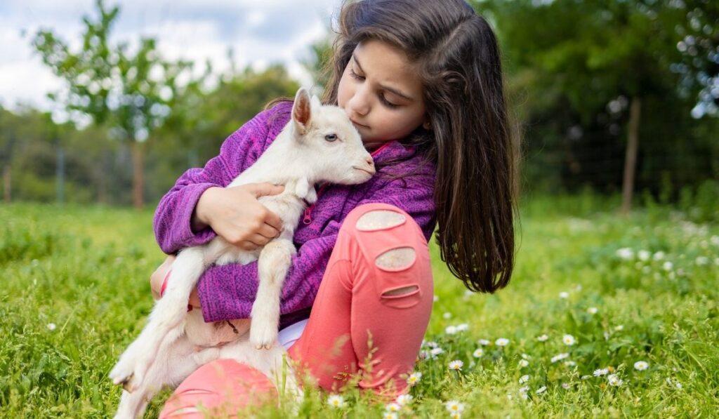 Girl Hugging Pet Goat