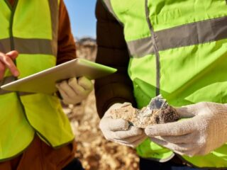 miners expecting a mineral in a land