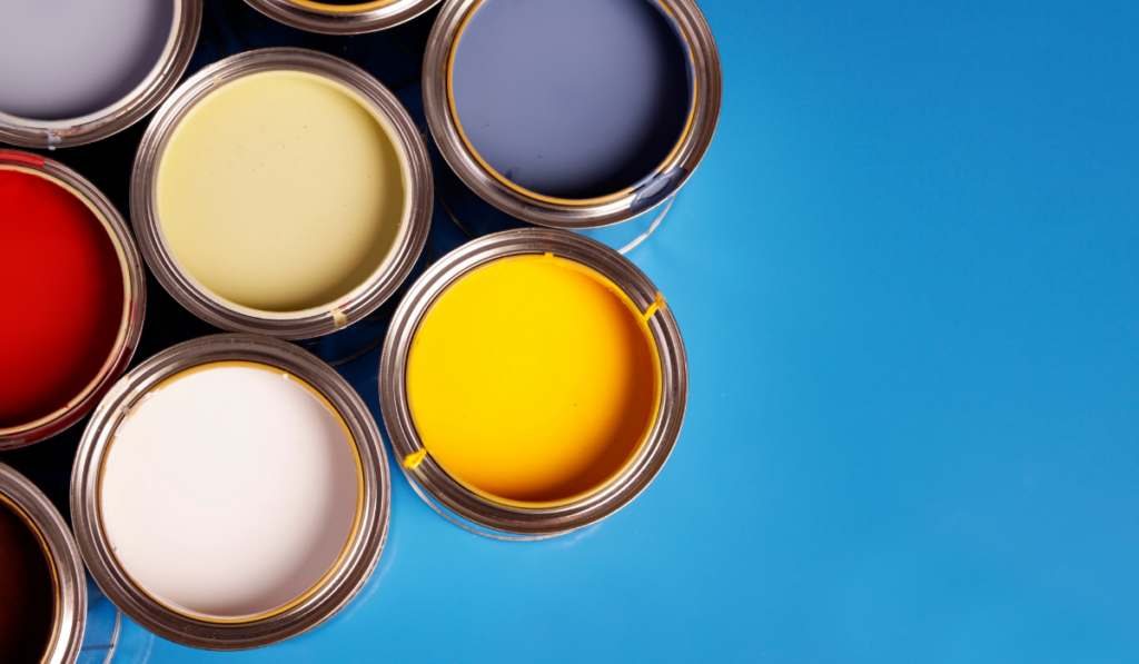 Paint cans on blue background.
