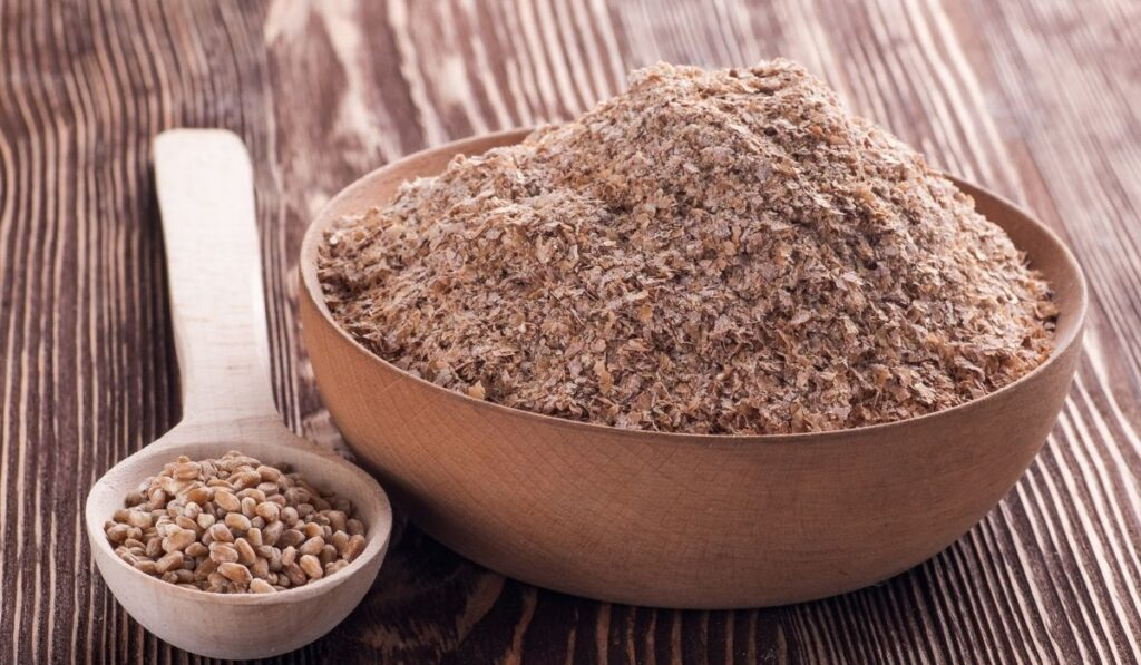 wheat bran on a wooden bowl