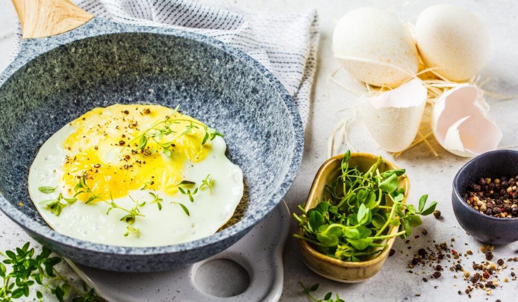 fried turkey egg on a gray pan