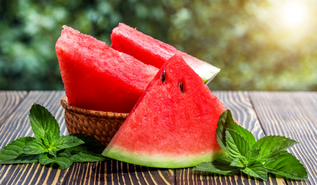 Sliced watermelon on a wooden table