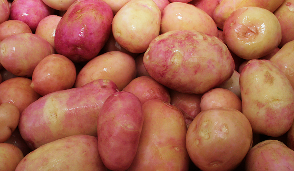 Clean raw potatoes